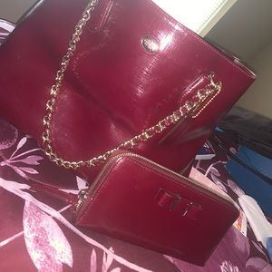 Selling a burgundy Coach tote and wallet